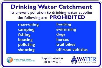 "Example of a sign displayed at a drinking water catchment. ""To prevent pollution to drinking water supplies, the following are prohibited: marroning, camping, fishing, boating, polluting, shooting, hunting, swimming, dogs, horses, trail bikes, off road vehicles"""